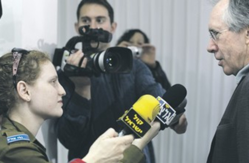 Army Radio reporter conducts interview 370 (photo credit: REUTERS)