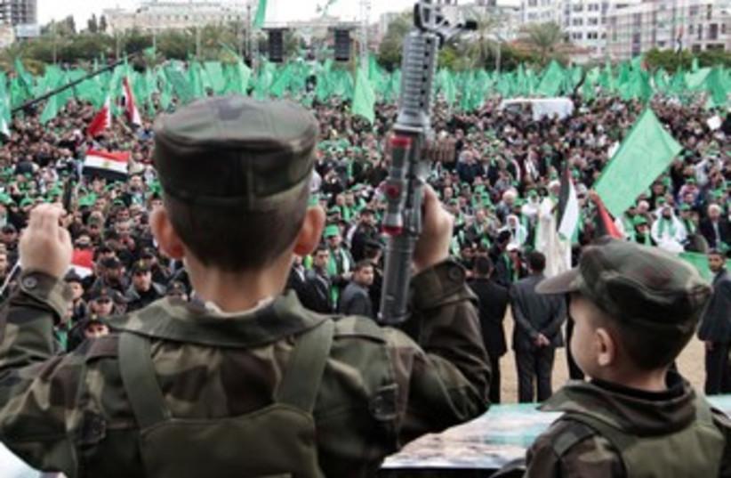 Palestinian children celebrate Hamas founding 370 (photo credit: REUTERS/Ahmed Jadallah)