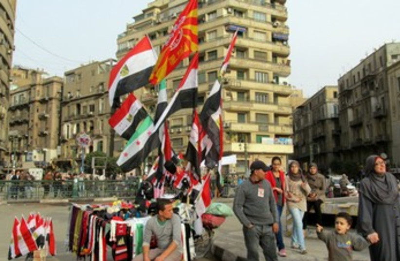 A vendor sells flags in Tahrir Square 370 (photo credit: MELANIE LIDMAN)