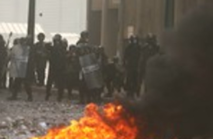 police throw stones at protesters in Alexandria 150 (photo credit: REUTERS/Asmaa Waguih)