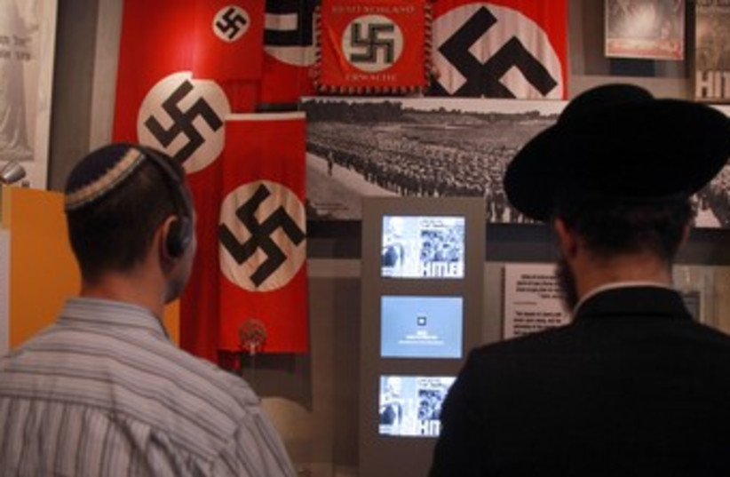 Jewish men looking at Holocaust exhibit in Yad Vashem 370 (photo credit: Marc Israel Sellem/The Jerusalem Post)