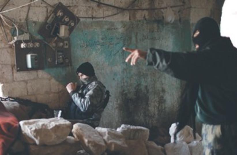 Jabhat al-Nusra fighters 370 (photo credit: Ahmed Jadallah/Reuters)