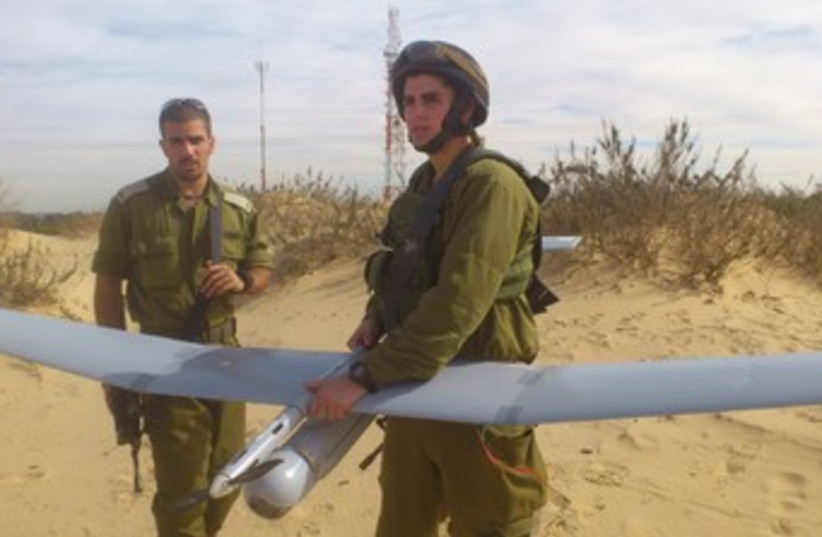 SEC.-LT. ITZIK COHEN holds a Sky Rider drone before takeoff  (photo credit: YAAKOV LAPPIN)