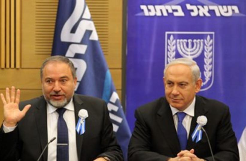 Liberman and Netanyahu at Likud Beytenu faction meeting 370 (photo credit: Marc Israel Sellem/The Jerusalem Post)