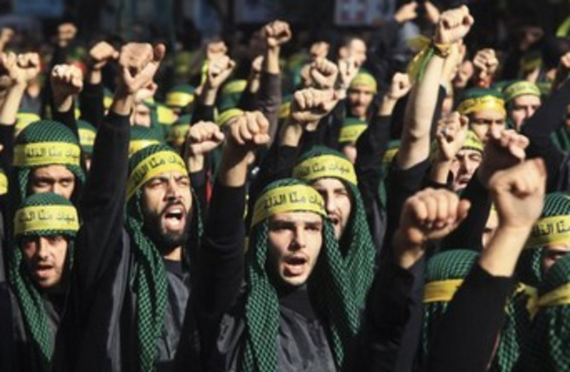Hezbollah march, fighters 370 (photo credit: Reuters/Khalil Hassan)