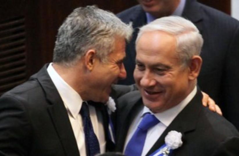 Lapid Netanyahu at Knesset swear in 370 (photo credit: Marc Israel Sellem/The Jerusalem Post)