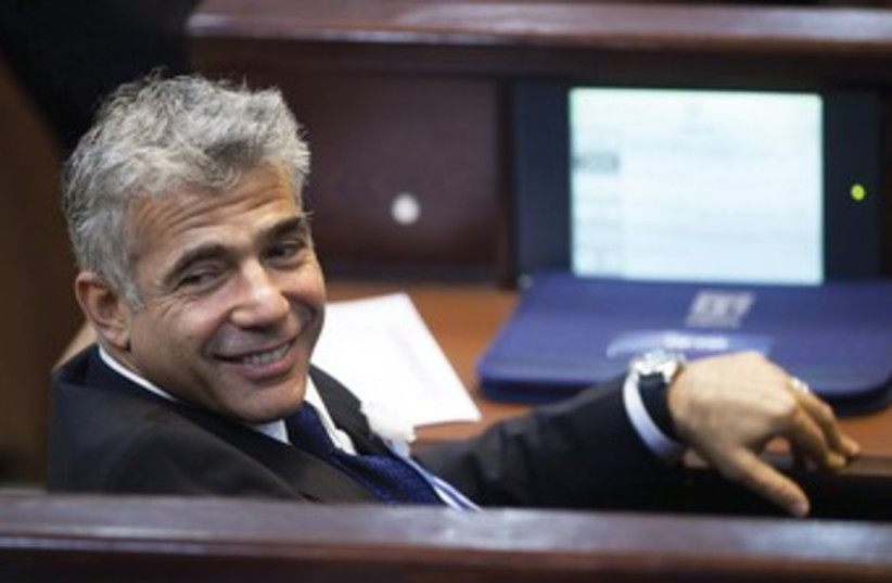 Lapid at Knesset 370 (photo credit: Uriel Sinai/Reuters)