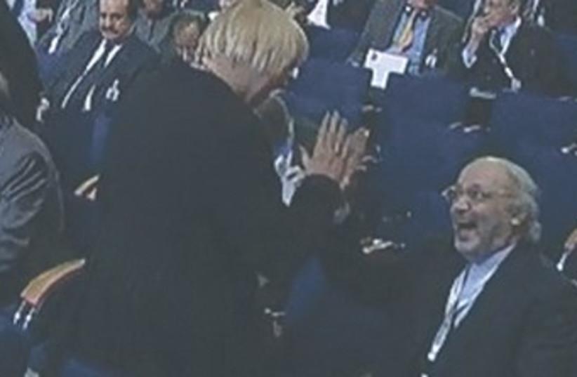 German politician high fives Iranian envoy 370 (photo credit: REUTERS)