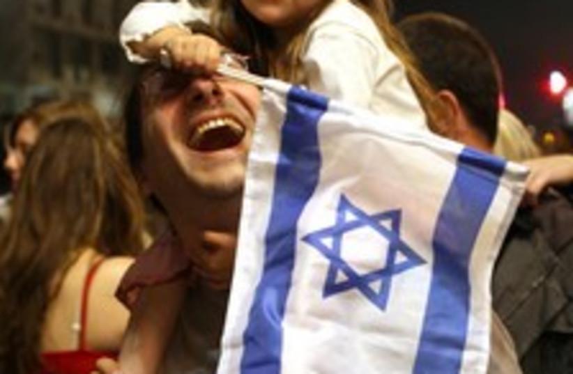 israeli flag girl 224 88 (photo credit: Ariel Jerozolimski)