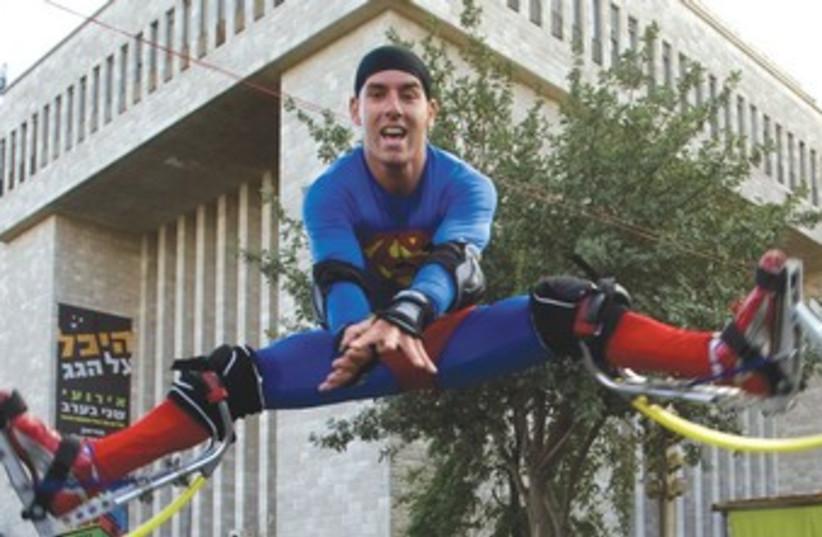 MAN dressed as Superman 370 (photo credit: Reuters)