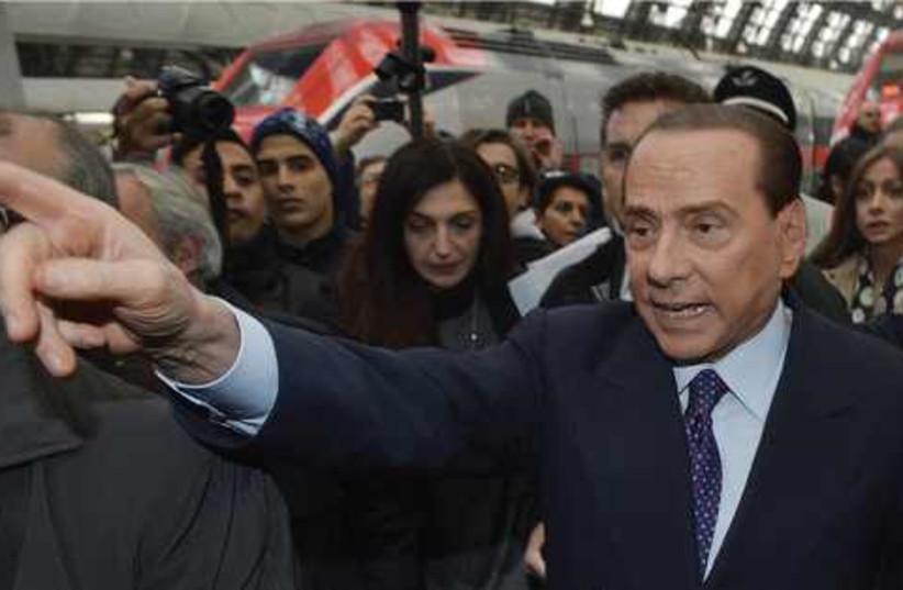 Former Italian prime minister Silvio Berlusconi 521 (photo credit: LORIS SAVINO / REUTERS)