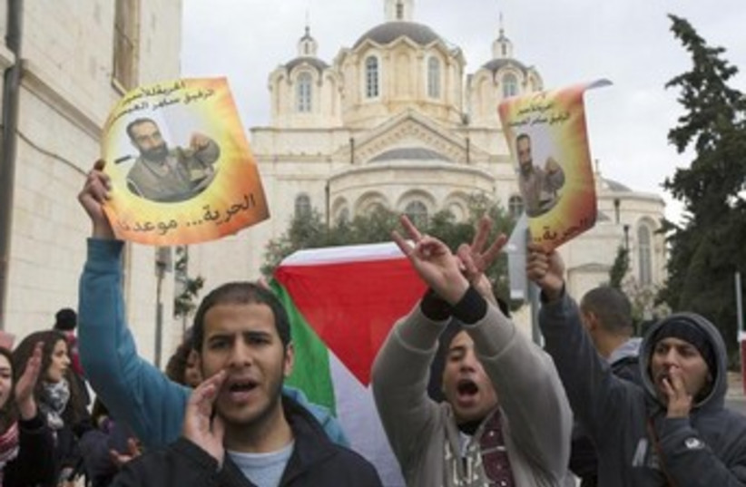 Palestinians protest in support of hunger striker 370 (photo credit: REUTERS)