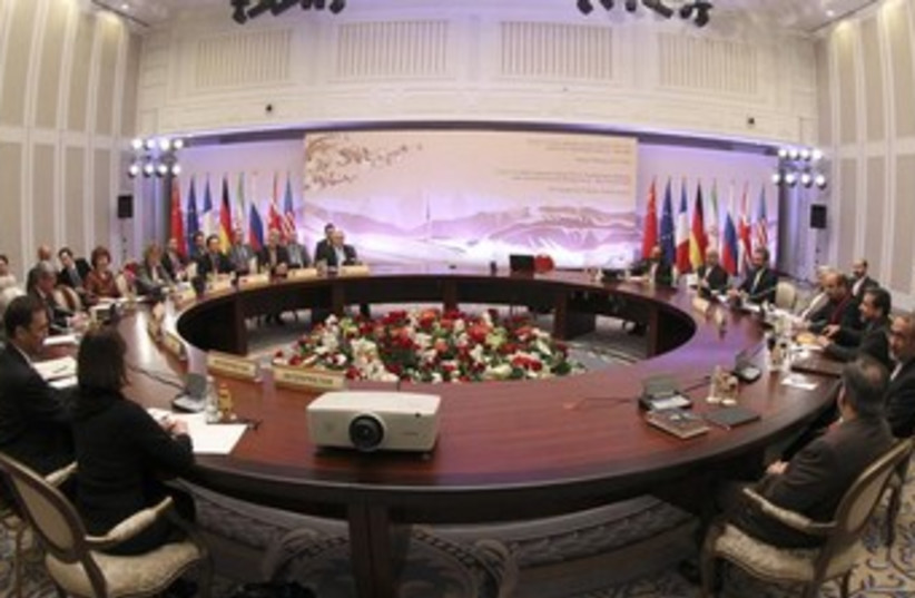 Participants sit at a table during talks on Iran (photo credit: REUTERS/Stanislav Filippov)