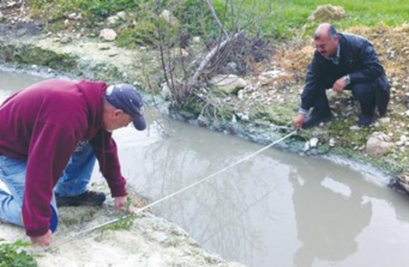Alon Tal testing water supply 370 (photo credit: Courtesy Alon Tal)