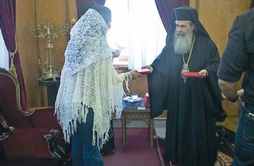 Israeli woman meets the greek patriach 521 (photo credit: JIM FLETCHER)