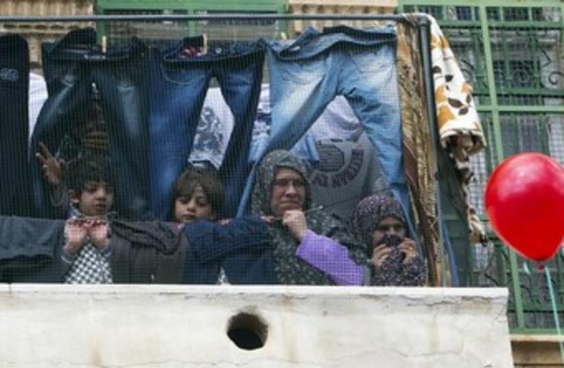 Palestinians in the West Bank (photo credit: REUTERS/Ronen Zvulun)