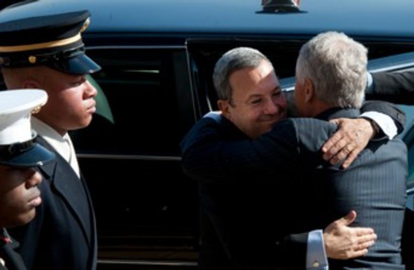 Defense Minister Barak embraces US counterpart Hagel 370 (photo credit: Courtesy Defense Ministry )
