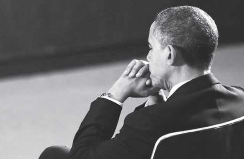 Gloomy Obama 521 (photo credit: KEVIN LAMAR QUE / REUTERS)