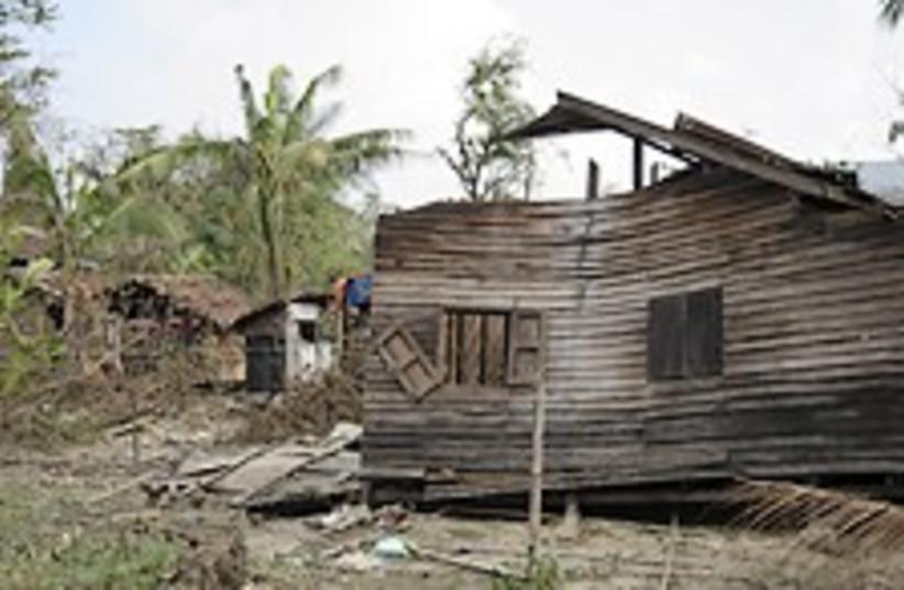 Mynmar huts 224.88 (photo credit: AP / Courtesy ADH)