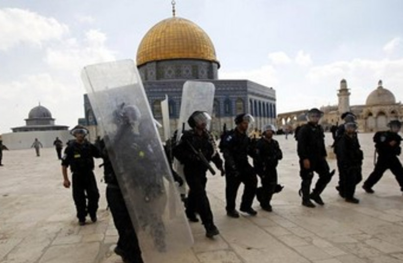 Israeli police in front of Al Aqsa mosque 370 (photo credit: REUTERS/Ammar Awad)