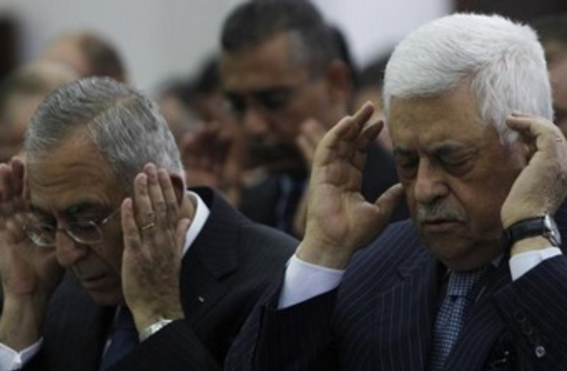 Abbas and Fayyad look like they have a headache, 370 (photo credit: REUTERS/Mohamad Torokman)