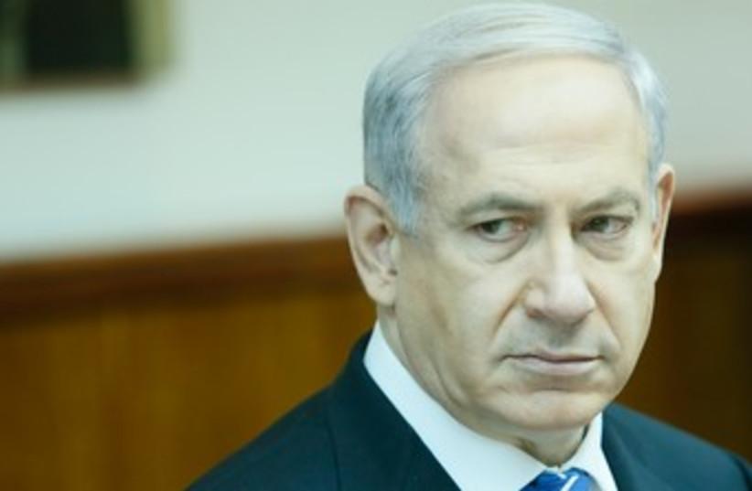 Netanyahu looking morose at cabinet meeting 370 (photo credit: GPO)