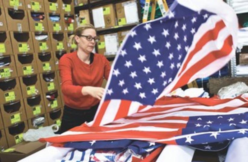 US flags prepared ahead of Obama visit 370 (photo credit: REUTERS)