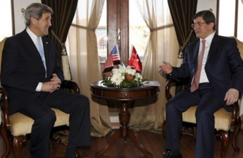 US Secretary of State Kerry with Turkish FM Davutoglu (photo credit: REUTERS/Jacquelyn Martin/Pool)