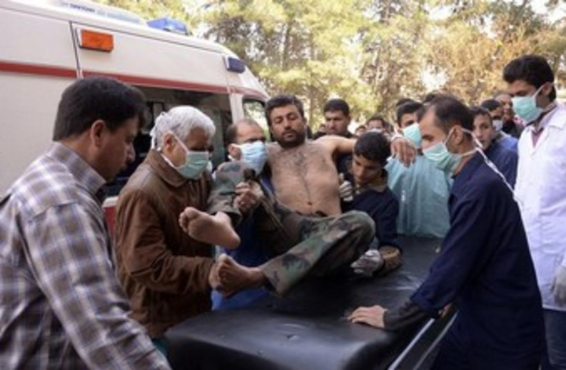 Syrian soldier injured in alleged chemical weapon attack 360 (photo credit: REUTERS/George Ourfalian)