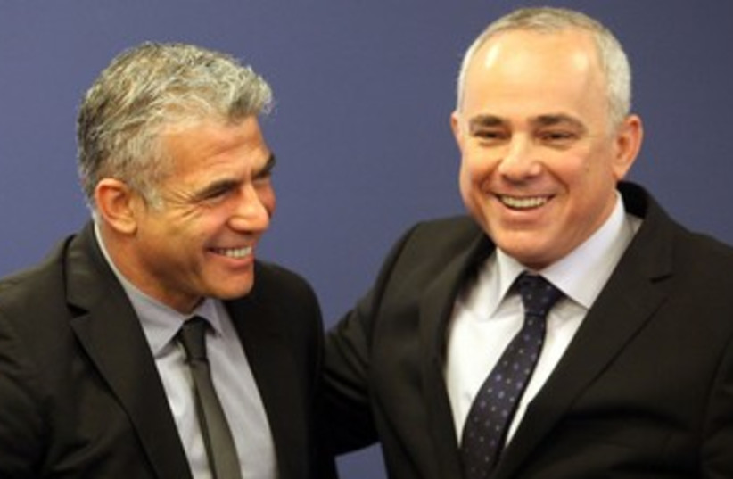 Lapid and Steinitz at Finance Ministry handover 370 (photo credit: Marc Israel Sellem/The Jerusalem Post)