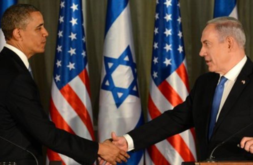 Obama and Netanyahu shake hands 390 (photo credit: Koby Gideon/GPO)