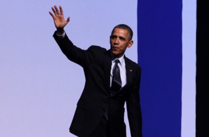 Obama waving after speech in Jerusalem 390 (photo credit: Marc Israel Sellem/The Jerusalem Post)