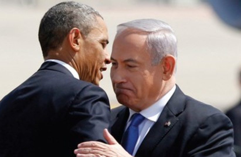 Netanyahu and Obama embrace 370 (photo credit: Jason Reeed/Reuters)