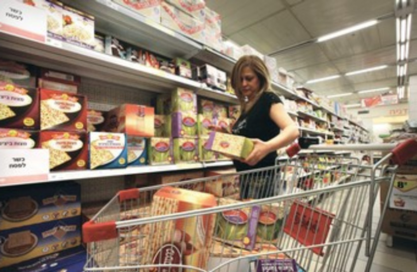 A woman shops for Passover 370 (photo credit: Marc Israel Sellem/The Jerusalem Post)