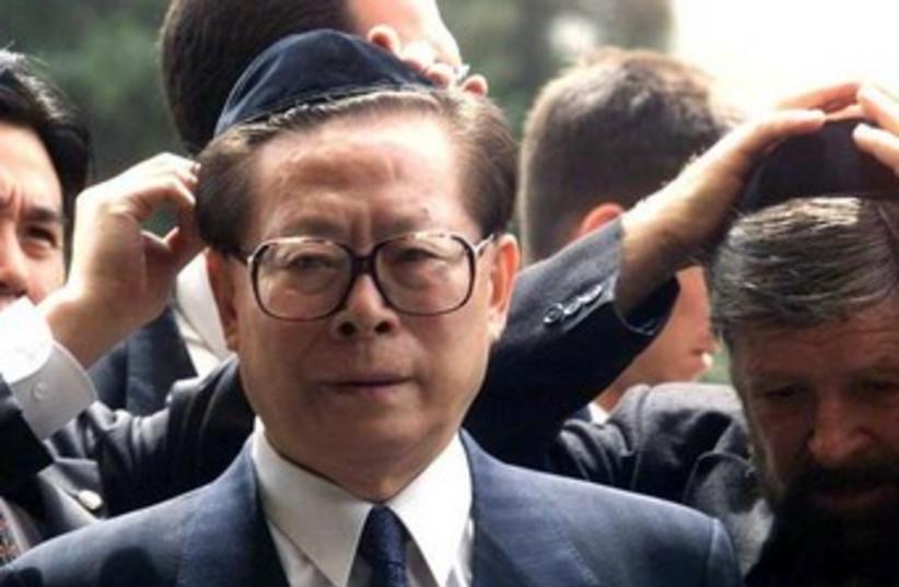 Former Chinese President Jiang Zemin at Yad Vashem 370 (photo credit: Reuters)