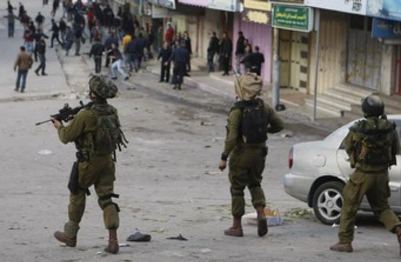 IDF soldiers in Hebron (photo credit: Reuters)