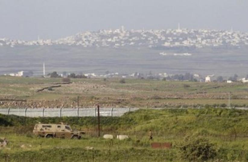 Golan border Syria truck 370 (photo credit:  REUTERS/Baz Ratner)