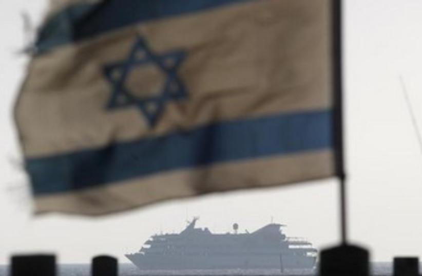 Mavi Marmara; Israeli flag, ship in background 370 (photo credit: REUTERS/Amir Cohen)