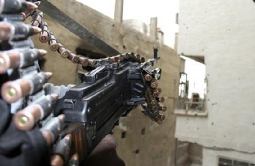 Syrian opposition fighter (photo credit: REUTERS/Ward Al-Keswani)
