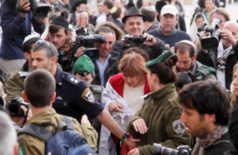Law enforcement officials escort Women of the Wall director Lesley Sachs at the Western Wall in Jerusalem (file photo) (photo credit: Marc Israel Sellem)