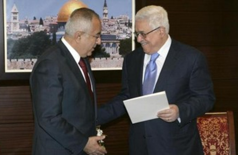 Abbas and Fayyad shake hands 370 (photo credit: REUTERS/Thaer Ganaim/PPO/Handout)