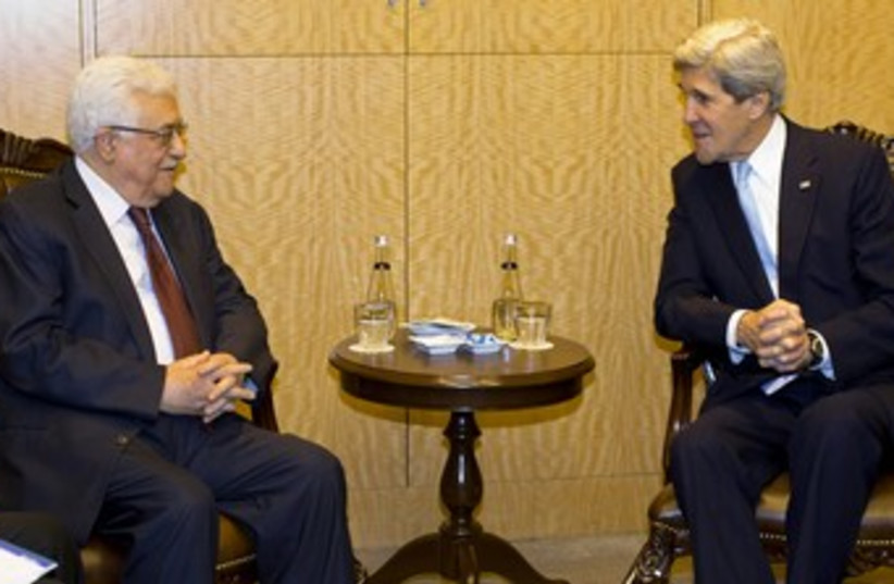 Kerry and Abbas in Istanbul 370 (photo credit: REUTERS/Evan Vucci/Pool)