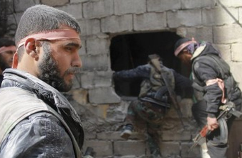 Free Syrian Army fighters in Jdeidet al Fadel 370 (photo credit: REUTERS/Malek Al Shemali)