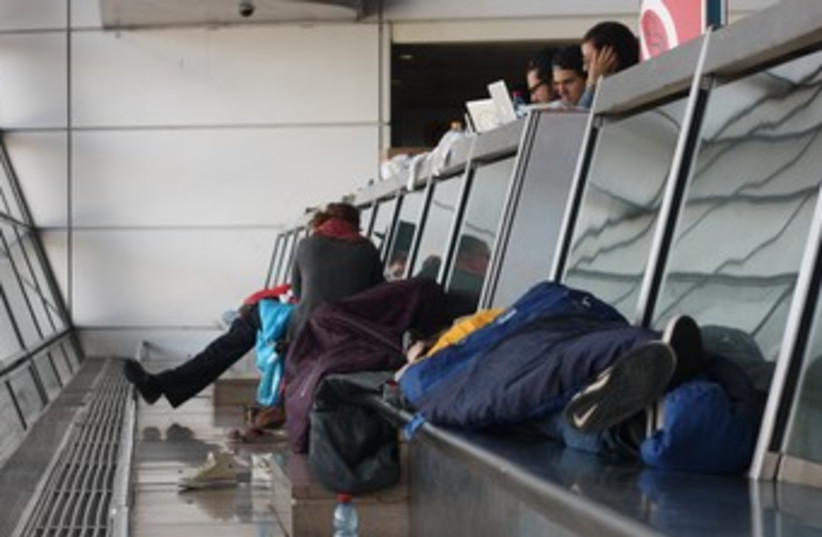 Passengers asleep at Ben Gurion airport during strike 370 (photo credit: Ben Hartman)