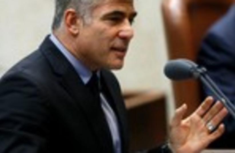 Lapid speaking at the Knesset 150 (photo credit: Marc Israel Sellem/The Jerusalem Post)