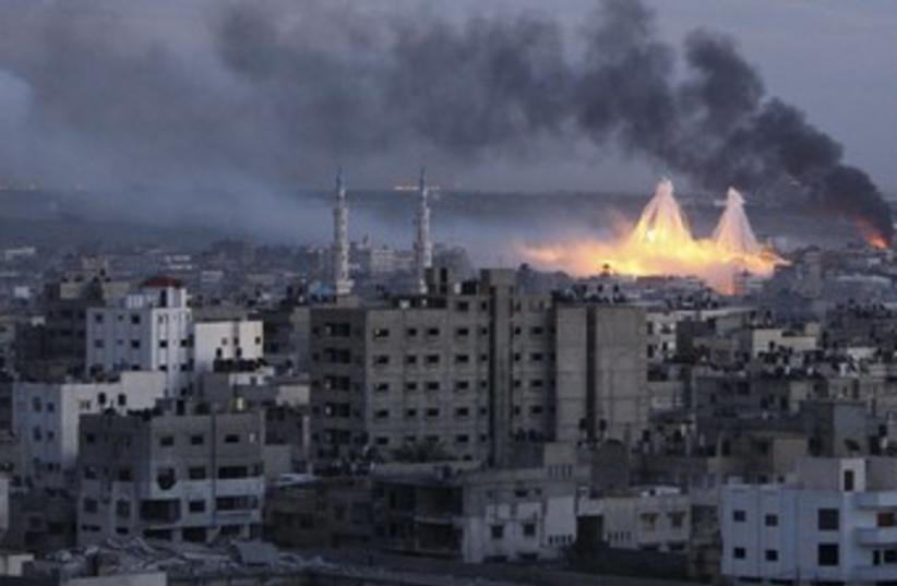 White phosphorus bombs exploding over Gaza city  (photo credit: REUTERS/Mohammed Salem)