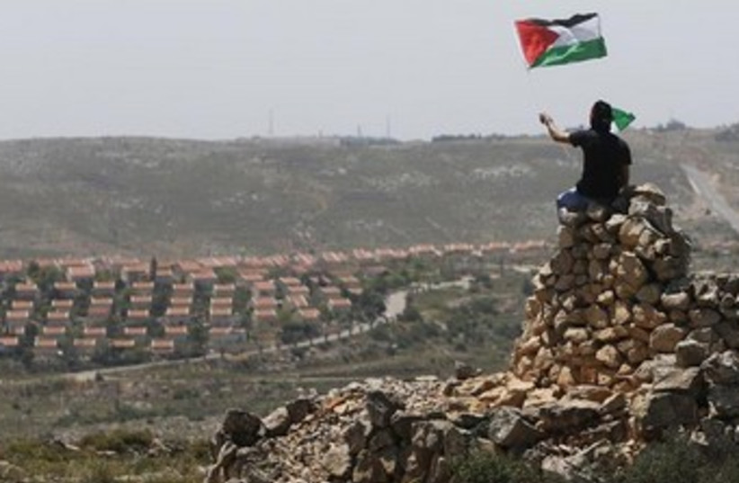 Palestinian with flag W. Bank370 (photo credit: REUTERS/Mohamed Torokman)