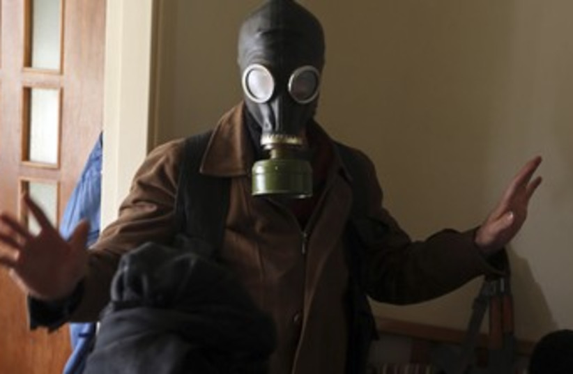 Syrian free army gas mask370 (photo credit: REUTERS/Goran Tomasevic)