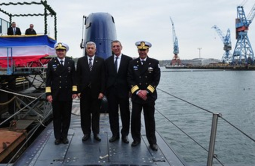 Dolphin submarine unveiled in Germany 370 (photo credit: Defense Ministry)