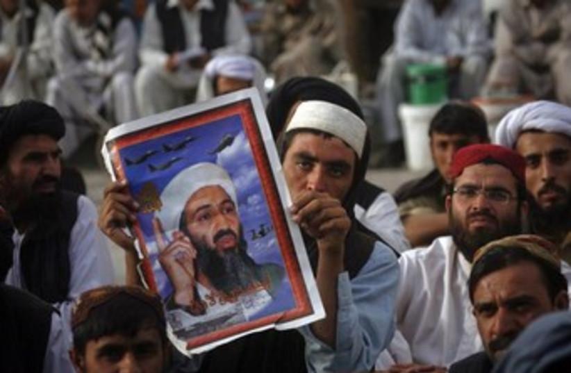 Osama bin Laden supporters in Pakistan 370  (photo credit: REUTERS/Naseer Ahmed )